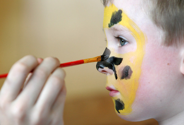 Manchester: Connor Howland, 5, gets his face painted like a jaguar at Manchetser Memorial Elementary School after running in the Hit the Street for Little Feet Road Race Saturday morning.  After his face was painted he ran outside with his sister to wait for his parents to cross the finish line of the 5k race held for older runners. Mary Muckenhoupt/Gloucester Daily Times