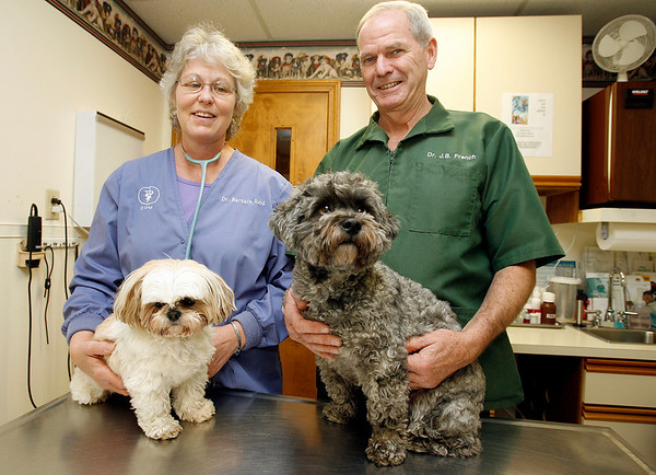 Gloucester: Dr. Barbara Reid and her husband, Dr. Jeffrey French, run the Cape Ann Veterinary Hospital in Gloucester. Shown here are two of their dogs, Scooter Lee, left, and Stevie Ray, right. Photo by Kate Glass/Gloucester Daily Times