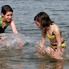 Essex: Julia Whitten, 12, of Essex splashes her sister, Anna, 5, while cooling off at Conomo Point yesterday afternoon as temperatures climbed into the 90s. Photo by Kate Glass/Gloucester Daily Times Tuesday, April 28, 2009