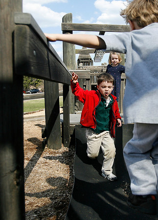 Essex: Sean O'Neill, 5, races across a ramp on the Essex Elementary School playground while doing an obstacle course with his friends after school on Thursday. Photo by Kate Glass/Gloucester Daily Times Thursday, April 9, 2009