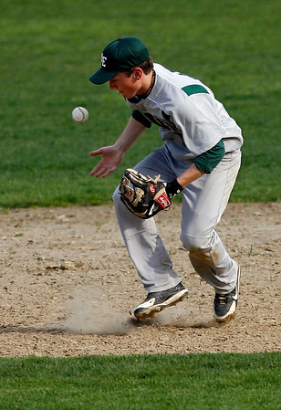 Essex: Manchester Essex's Alex Ray bobbles the ball, but still makes the throw to first for an out during their game against Lynnfield yesterday afternoon. Photo by Kate Glass/Gloucester Daily Times Tuesday, April 28, 2009