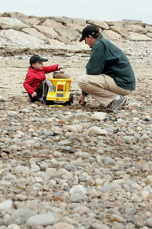 Gloucester: Sebastian Christo tries to stack as many rocks as he can in his truck with his dad Jared at xxx beach Saturday afternoon. Mary Muckenhoupt/Gloucester Daily Times