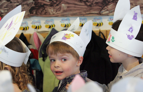 Gloucester: David Cutler, 5, parades around with his friends, including Aidan Cornetta, right, to show off their bunny hats as the Riverview Preschool gets ready for their egg hunt Friday morning.  The Eatser Bunny left plenty of colorful eggs for the kids to find in the yard outside the school. Mary Muckenhoupt/Gloucester Daily Times