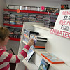 Manchester: Caroline Pratt, 8, looks through some children's movies for sale at Video Viewpoint in Manchester Saturday.  Because not enough people rent movies anymore Video Viewpoint will be closing it's door at the end of the month. Mary Muckenhoupt/Gloucester Daily Times