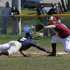 Gloucester: Gloucester first baseman Trevor Curley catches the ball just as Danvers' Eric Burgos tags the plate during the baseball game at Nate Ross Field Friday morning. Gloucester defeated Danvers 3-0. Mary Muckenhoupt/Gloucester Daily Times