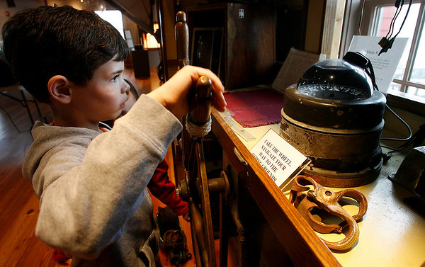Gloucester: Seamus Webster, 7, takes a turn manning the wheelhouse at the Maritime Heritage Center. The center recently completed a renovation, creating more space for hands-on exhibits. Photo by Kate Glass/Gloucester Daily Times Tuesday, April 21, 2009