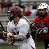 Gloucester: Salem's Nate Staples, right, chases down Gloucester's James Riley during their game at Newell Stadium yesterday. Photo by Kate Glass/Gloucester Daily Times Monday, April 20, 2009