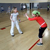 Manchester: Maddie Trumble smiles as she plays tag with her classmates at the Manchester Athletic Club as part of their Enrichment program, which includes tennis, excercise, nutrition and science classes. Twelve area schools are participating in the program. Photo by Kate Glass/Gloucester Daily Times Wednesday, April 8, 2009.