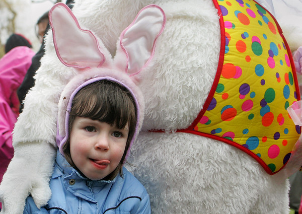 Rockport: Lauren O'Connor, 3, of Rockport poses with the Easter Bunny after the egg hunt at Millbrook Meadow Saturday afternoon.  Despite the rainy weather plenty of kids came to collect as much candy and eggs as they could. Mary Muckenhoupt/Gloucester Daily Times