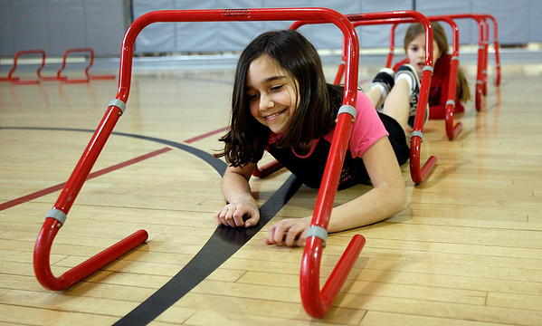 Manchester: Katelyn Moore and Montana Marshall of West Gloucester Girl Scout Troop 60548 go through an obstacle course at the Manchester Athletic Club on Thursday afternoon as they work on their Sport Sampler Badge. Photo by Kate Glass/Gloucester Daily Times Thursday, March 19, 2009