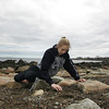 Rockport: Laura Renner looks through the rocks and sand for sea glass at Back Beach Saturday afternoon. Laura said that she has many jars of sea glass at home. Mary Muckenhoupt/Gloucester Daily Times