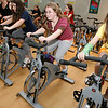 Manchester: Courtney Feuerbach, right, laughs as she takes a spinning class with Brittni Larcom, center, and Sara Stanton, left, at the Manchester Athletic Club yesterday. The girls, who are part of Girl Scout Troop 85, were working on their Sport Sampler Badge. Photo by Kate Glass/Gloucester Daily Times Thursday, March 19, 2009