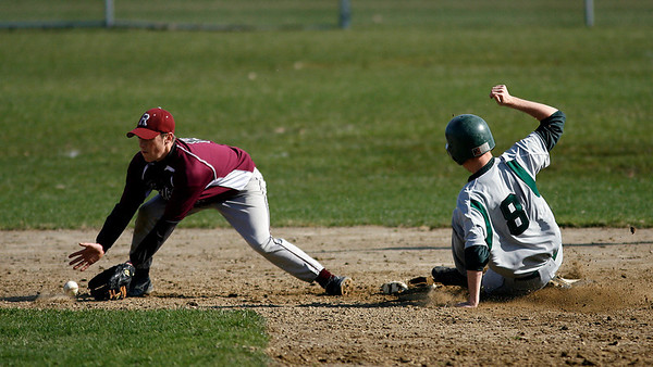 Manchester: Rockport's Pat Frithsen scoops up a late throw as Manchester Essex's Zeke Gillette steals second base at Memorial Field yesterday afternoon. The Vikings won 14-7. Photo by Kate Glass/Gloucester Daily Times Thursday, April 9, 2009