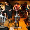Manchester: Marcy Plante of the Manchester Athletic Club helps Melissa Schuh increase resistance on her spinning cycle as she rides with Sarah Janowicz, Julia Bonaecorso, and other members of Girl Scout Troop 85 on Thursday. The girls were working on their Sport Sampler Badge. Photo by Kate Glass/Gloucester Daily Times Thursday, March 19, 2009