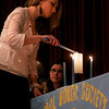 Rockport: Mayer Andersen lights the candle representing scholarship during Rockport High School's National Honor Society Induction Ceremony on Tuesday night. Twenty-seven students were inducted into the Catherine E. Churchill Chapter. Photo by Kate Glass/Gloucester Daily Times Tuesday, April 7, 2009