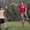 Rockport: Rockport senior Jake Moss catches a Frisbee in the air in front of sophomore Zak Kennedy as the ultimate Frisbee team practices before their first match of the season against Andover at Rockport High School Thursday afternoon.  This is the second year for Rockport's ultimate Frisbee team and have broken the players up into A and B teams.  The obstacle the team had to face Thursday was how to control the Frisbee in the wind. Mary Muckenhoupt/Gloucester Daily Times
