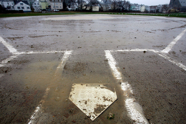 Gloucester: Heavy rain canceled the Gloucester softball season opener at Burnhams Field yesterday. All sporting events, including the Red Sox season opener, were postponed. Photo by Kate Glass/Gloucester Daily Times Monday, April 6, 2009