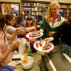 "Manchester: Eliza Logue, 11, center, and Bailey Graves, 12, right, pass out stuffed strawberry desserts to Nellie Boling, 10, Emily Stanton, 9, and Isabella Schmidt, 10, during a cooking class at the Manchester Public Library yesterday afternoon. Katie Wilton, author of ""You're the Cook! A guide to mixing it up in the kitchen"" also taught the kids to make fruit smoothies, parmesan pita triangles, pizza wontons, and deviled eggs. Photo by Kate Glass/Gloucester Daily Times Tuesday, April 21, 2009"