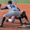Gloucester: Gloucester's Colin Rogers dives back toward first base as St. John's Prep's Kevin Davis reaches for the ball during their season opening game in Danvers yesterday afternoon. Photo Kate Glass/Gloucester Daily Times Wednesday, April 8, 2009