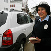 Gloucester: Carolyn Foote, who has been a meter maid in Gloucester since 1973, will be putting away her ticket book as she takes the city's early retirement proposal due to budget cuts. Photo by Kate Glass/Gloucester Daily Times Wednesday, April 1, 2009