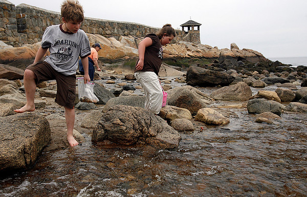 Rockport: Chris Boyd, 10, of Franklin and his sister Mackenzie, 9, search for sea glass and pottery at Front Beach yesterday afternoon. The two combine their findings into a family jar so they can be reminded of the beach. Photo by Kate Glass/Gloucester Daily Times Wednesday, April 22, 2009