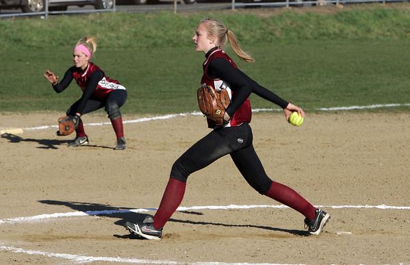 Gloucester: Gloucester's Kelly Benson winds up a pitch during the softball game against Saugus at Burnham's Field Wednesday afternoon. Gloucester lost to Saugus 15-5. Mary Muckenhoupt/Gloucester Daily Times