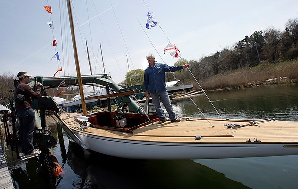 Gloucester: Graham Tutill, systems engineer for the restoration of a 1940s Alden class sailboat, stands aboard The Spirit during the boat's launch at River Boat Works at Montgomery Boat Yard yesterday afternoon. Photo by Kate Glass/Gloucester Daily Times Monday, April 27, 2009
