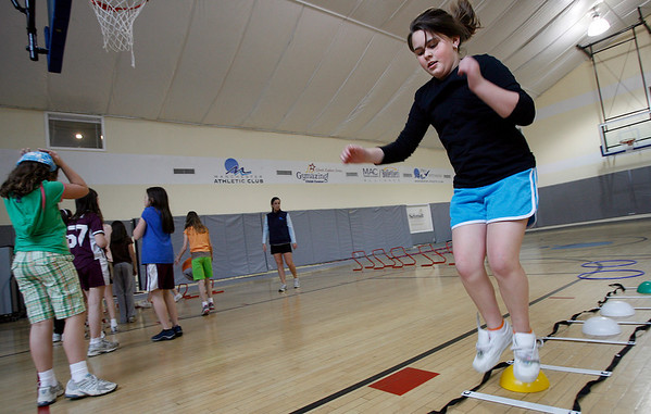 Manchester: Mckenzie Plant of West Gloucester Girl Scout Troop 60548 goes through an obstacle course at the Manchester Athletic Club as the troop works toward their Sport Sampler Badge on Thursday. Photo by Kate Glass/Gloucester Daily Times Thursday, March 19, 2009