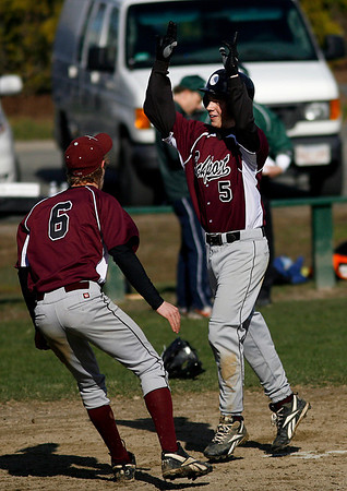 Manchester: Rockport's Chris Trenti points to the sky as he crosses home plate following his grand slam in the third inning of their game against Manchester Essex at Memorial Field yesterday afternoon. The Vikings won 14-7. Photo by Kate Glass/Gloucester Daily Times Thursday, April 9, 2009