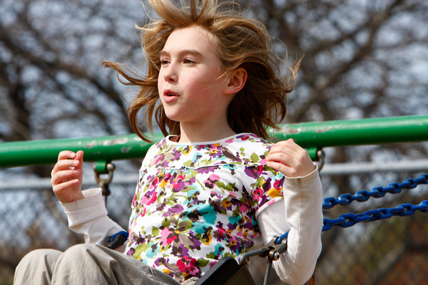 Rockport: Elisabet Kanegis ,10, swings as high as she can while enjoying the afternoon at Amelia Grace Place playground behind Rockport Elementary School Wednesday afternoon. Mary Muckenhoupt/Gloucester Daily Times