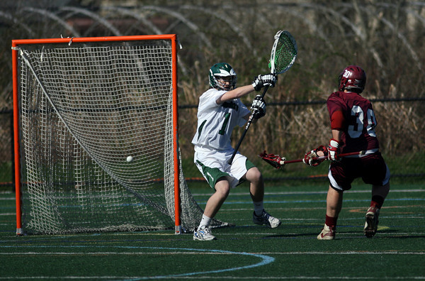 Manchester: Gloucester's Jeff Lane gets the ball past Manchester Essex goalie Reed Parkhurst during their game at Coach Ed Field Field yesterday afternoon. Photo by Kate Glass/Gloucester Daily Times