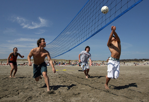 Gloucester: Brooke Baker, Mike Bruno, Chris Hardie, and Tom Oka play volleyball at Good Harbor Beach yesterday as the temperature climbed into hte 80s. Photo by Kate Glass/Gloucester Daily Times