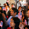 Gloucester: Romel Ortega originally of Honduras waves his American flag during the naturalization ceremony held in Gloucester City Hall Thursday afternoon.  One hundred and twenty four people received their citizenship yesterday in historic Gloucester, a location choosen by Judge Robert B. Collings who peroformed the naturalization. Mary Muckenhoupt/Gloucester Daily Times