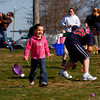Gloucester: Bailee Militello, 4, runs for Easter eggs on the lawn of Stage Fort Park during the Easter egg hunt organized by the Trinity Congregational Church Saturday morning. The eggs were hidden all around the gazebo for the kids to gather as fast as they could. Also pictured is Jacob Russell, 11, right.  Mary Muckenhoupt/Gloucester Daily Times