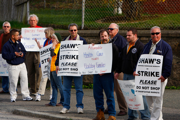 Gloucester: Picketers stand across the street from the Shaws on Railroad Avenue in support of striking Methuen Shaws workers. Mary Muckenhouot/Gloucester Daily Times