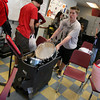 Gloucester: Ryan Hull pushes drums through the music room at Gloucester High School as the Docksiders prepare for their trip to Hawaii. The band leaves on Friday at 3am. Photo by Kate Glass/Gloucester Daily Times