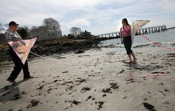Gloucester: Rich Weisenbach and his granddaughter, Molly Weisenbach, fly kites at Gray Beach in Magnolia on Monday. Photo by Kate Glass/Gloucester Daily Times