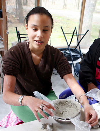 Rockport: Precious Perez, 12, molds some clay as Cythia Curtis teaches a pottery class for the vision impaired at her studio in Rockport Saturday morning.  Children from the Beverly YMCA came to learn pottery and make bowls for the empty bowl dinner thanks to a grant through the Massachusetts Commission for the Blind. Mary MuckenhouptGloucester Daily Times