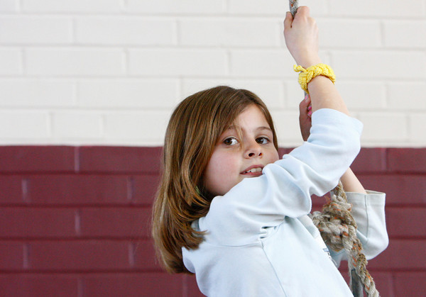 Rockport: Collen Murphy clims the rope at the Gum Tree Climbing staion of the Australian Olympics at the Rockport Elementary School Thursday afternoon.  The second graders took place in the olympics which included a Dingo Dash, Kangaroo Hop and Ayer Rock Climbing. Mary Muckenhoupt/Gloucester Daily Times