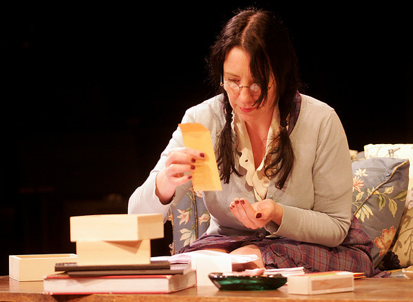 """Gloucester: Tillie, played by Lauren Suchecki, looks at her marigold seeds as she rehearses a scene from the Cape Ann Theatre Collaborative's production of """"The Effect of Gamma Rays on Man-in-the-Moon Marigolds"""" by Paul Zindel. The performance will be at the Gorton Theatre, home of Gloucester Stage Company, on April 30, May 1, 2. Photo by Kate Glass/Gloucester Daily Times"""