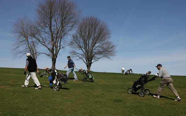 Essex: Will McRae, Dave Haszard, Ben Reid, and Dana Snow play a round of golf at the Cape Ann Golf Course on Thursday afternoon. Although the rain turned a couple sand traps into water hazards, the course was relatively dry. Photo by Kate Glass/Gloucester Daily Times