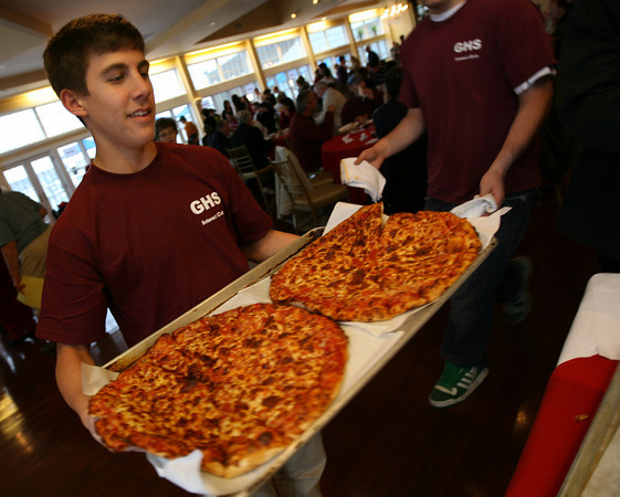 Gloucester: Christian Favalora of the GHS Interact Club brings out more pizzas during the Relay for Life Pizza Taste-Off fundraiser at Cruiseport. All proceeds from the event go to the American Cancer Society. Photo by Kate Glass/Gloucester Daily Times ****Photo Kicker - A Slice of Life*****