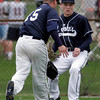 Gloucester: St. John's Prep's Alex Markakis and Cameron Davey watch as a fly ball lands between them during their 7-6 loss to Gloucester yesterday afternoon. Photo by Kate Glass/Gloucester Daily Times