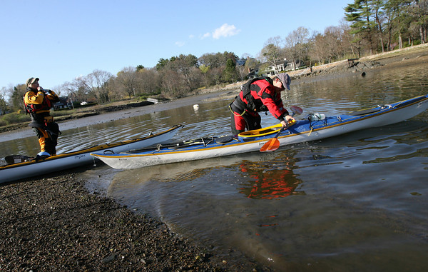 Manchester: Phil and Laurie Allen launch their kayaks off Tuck's Point yesterday afternoon. The two, who are from Boston, learned about the area through the North Shore Paddlers Network. Photo by Kate Glass/Gloucester Daily Times