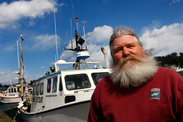 Gloucester: Gloucester fisherman Paul Cohen stands in front of his boat Sasquatch III at Jodrey State Fish Pier Thursday. Mary Muckenhoupt/Gloucester Daily Times