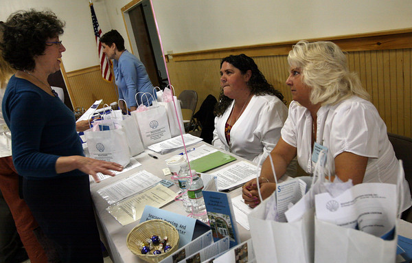 Gloucester: Carolin Catalano talks with Mary Burnham and Darlene Richards of Seacoast Nursing & Rehab during the Cape Ann Job Fair hosted by North Shore Career Centers at the Masonic Temple yesterday morning. Over 500 people attended the fair, which featured 14 Cape Ann companies who are currently hiring. Photo by Kate Glass/Gloucester Daily Times