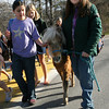 "Essex: Rebecca Braimon pats Hope as Veronica Attridge guides the miniature horse alongside a ""walking school bus"" to Essex Elementary School yesterday morning. Photo by Kate Glass/Gloucester Daily Times"