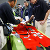 Gloucester:  Jim Langford of the U.S. Coast Guard explains how the emergeny survival suit works to Joey Ciaramitaro as Joe Orlando, center, listens during the Fishing Fanily's Health and Safety Fair at the Gloucester Coast Guard Station Saturday. Mary Muckenhoupt/Gloucester Daily Times