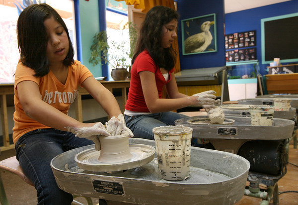 Gloucester: Adrienne Tse, 10, and Danielle Tse, 12, make mugs to give to their mom for Mothers Day at Cape Ann Art Haven on Monday afternoon. Art Haven has many programs for kids of all ages during vacation week. Photo by Kate Glass/Gloucester Daily Times