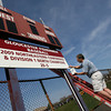 Gloucester: Don Ressel puts the finishing touches on the Gloucester baseball team's new sign at theO'Maley Middle School field commemorating their succesful season last year. Photo by Kate Glass/Gloucester Daily Times